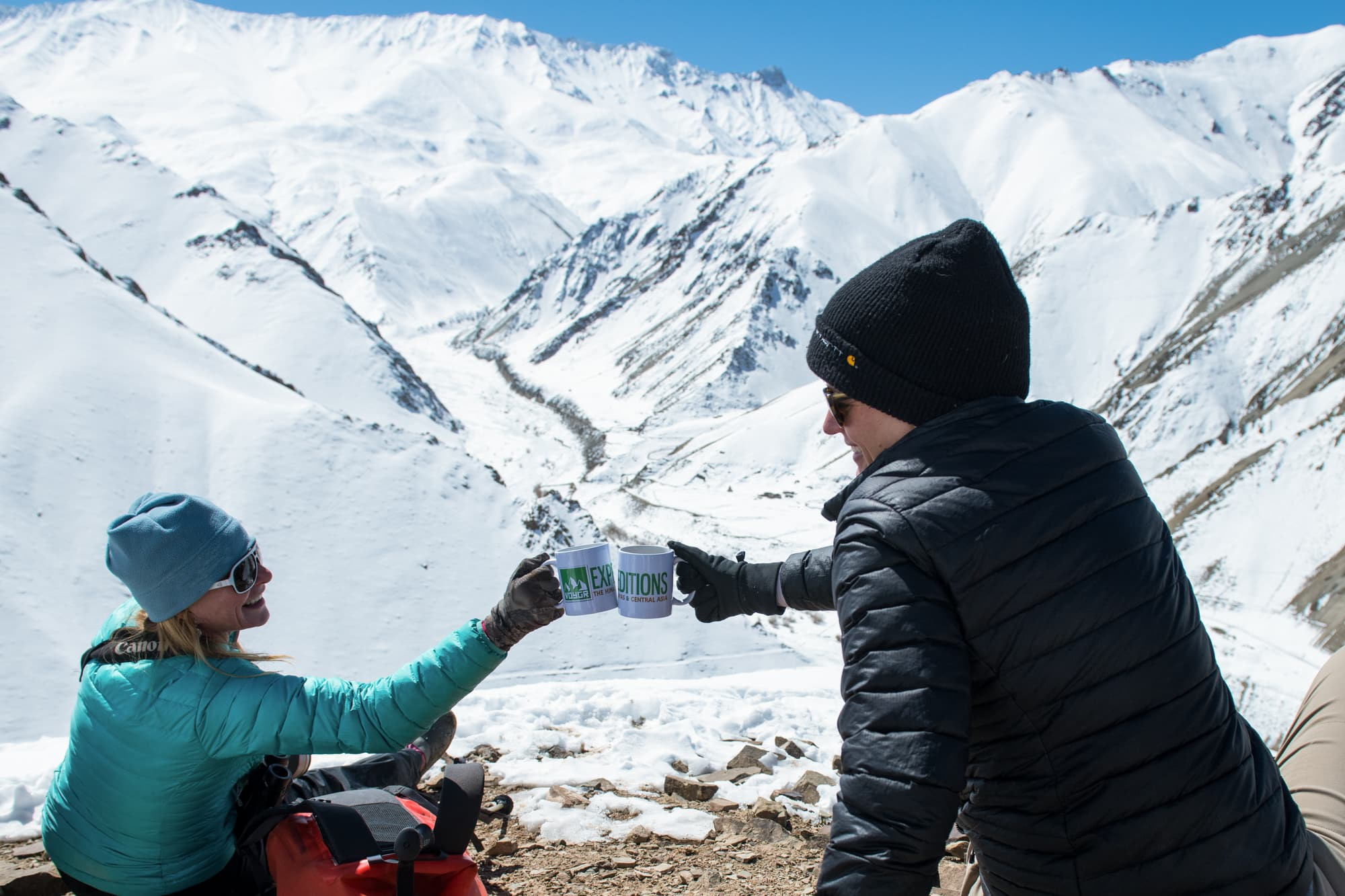 Guests Enjoying A Coffee During A Snow Leopard Sighting
