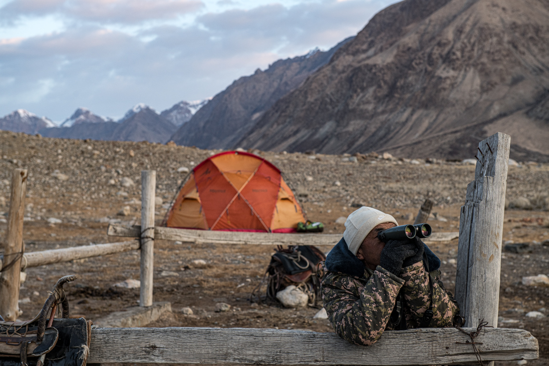 A Ranger Scans For Wildlife From Base Camp At The Sarychat Ertash Reserve On The Snow Leopard Expedition To Kyrgyzstan